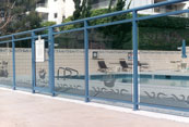 swimming pool with glass railing