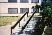stairway with an aluminum handrail